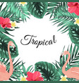 Tropical jungle palm leaves flamingo flowers frame