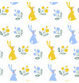 Spring seamless pattern with rabbits on a white