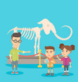 kids with a teacher studying a skeleton in museum vector image vector image