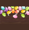 colorful easter eggs on wood background vector image
