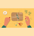 hands tying a brown box or package with string vector image vector image