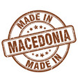 made in macedonia brown grunge round stamp vector image vector image