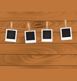 retro photos on rope on wooden background vector image vector image