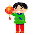 young dark-haired asian man holding red lantern vector image