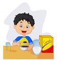 little girl having breakfast cereals with milk