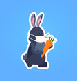 rabbit in mask holding carrot happy easter spring vector image vector image