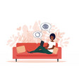 african american woman sitting on sofa with laptop vector image vector image