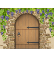 Arch of stone grapes and wooden door