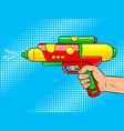 hand with water gun pop art vector image vector image