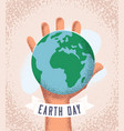human hand holding earth planet earth day concept vector image