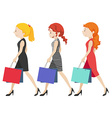 Three women walking with shopping bags vector image