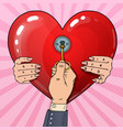 mens hand with key from womans heart pop art vector image vector image