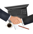handshake over paper and pen vector image vector image