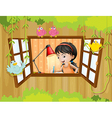 A girl studying near the window with birds vector image vector image