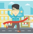 Businessman crossing finish line vector image vector image