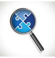 magnifying glass on a blue jigsaw vector image vector image