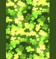 seamless festive texture with a happy four-leaf vector image vector image