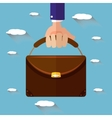 Hand holding briefcase flat style vector image