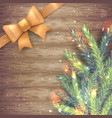 fir tree branch and gold ribbon on wood background vector image