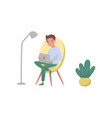 smiling guy sitting on armchair and using laptop vector image