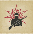 terrorist with gun old background vector image