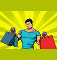 strong muscular man with bags on sale vector image vector image