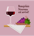 wine glass beaujolais nuvo with red grapes vector image vector image