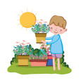 little boy lifting houseplant in the garden vector image vector image
