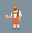 man hold beer mug wearing traditional german vector image vector image