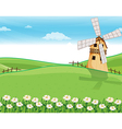 A farmhouse above the hills with a windmill vector image vector image
