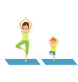 mom and son doing yoga vector image vector image