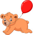 cartoon little bear with a red balloon vector image vector image