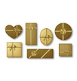 gold colored gift boxes with golden ribbons and vector image vector image