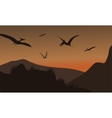Silhouette of pterodactyl flying at afternoon vector image vector image