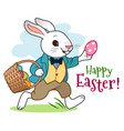 easter bunny rabbit with basket full of eggs vector image vector image