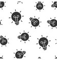 light bulb icon seamless pattern background vector image