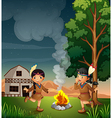 Two little Indians with a campfire vector image vector image