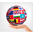 Flags of the world in globe and hand vector image vector image