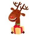 Cartoon cute christmas deer holding a gift box vector image