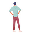 man standing back holding hand on hip isolated