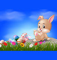easter bunny and eggs sitting on the stone vector image vector image