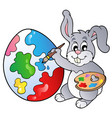 bunny artist painting easter egg vector image vector image