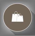 shopping bags sign white icon on brown vector image vector image