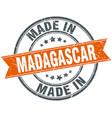 Madagascar orange grunge ribbon stamp on white