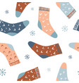winter seamless pattern with cute socks vector image vector image