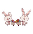 bunnies with wheelbarrow and easter egg icon vector image