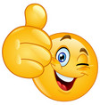 thumb up winking emoticon vector image vector image