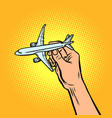 passenger plane in hand metaphor of travel and vector image vector image