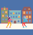people playing snowball fight in evening city vector image vector image
