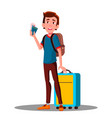 young cool happy guy at airport with suitcase vector image